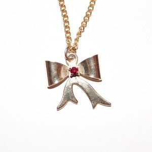 Jewelry - Gold bow necklace