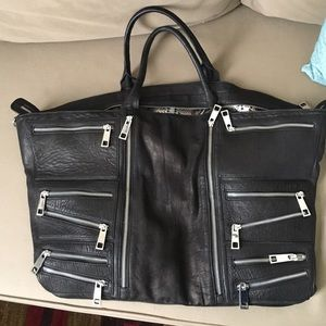 Aqua Madonna Handbags - Black leather tote with silver zippers