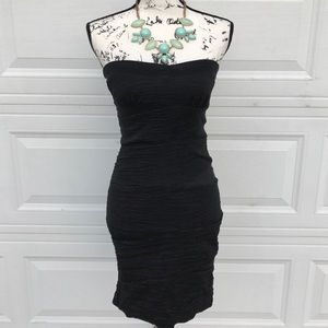 Snap Dresses & Skirts - Sexy Black cocktail dress with rouching detail