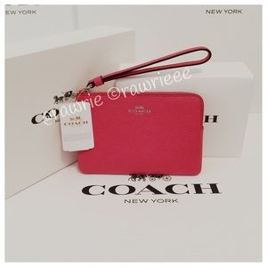 Coach Handbags - New Coach pink leather wristlet with gift box