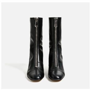 Black leather boots with front zipper