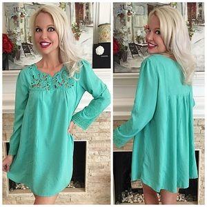 Mint crochet lace front detail tunic dress.