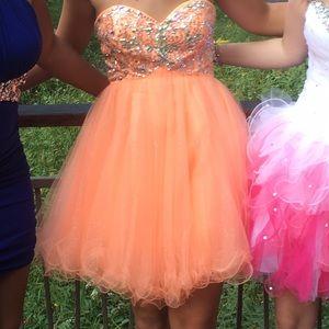 Bella Rene Dresses & Skirts - I'm selling my orange homecoming dress