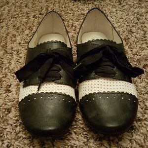 Black and white shoes by not rated