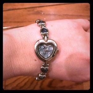 Silver heart shaped watch