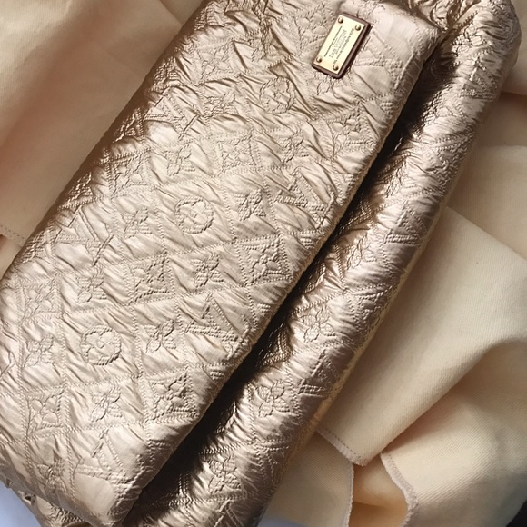 5414f192336f Louis Vuitton Handbags - Louis Vuitton limelight clutch GM