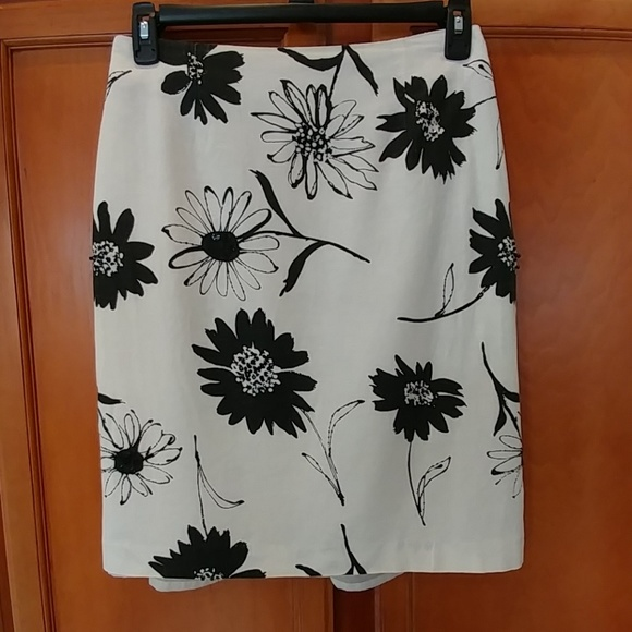 Dresses & Skirts - Cream and black floral skirt.