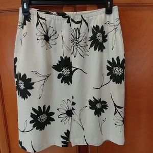 Skirts - Cream and black floral skirt.