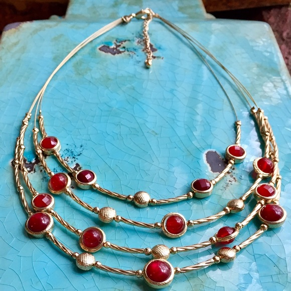 Four strand wire necklace with red stones