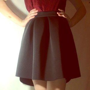 Black, stylish, scuba skirt.