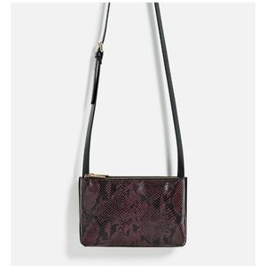 Maroon embossed croco cross body bag