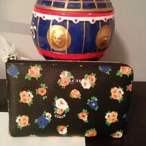 Coach Handbags - COACH TEA ROSE CORNER ZIP WRISTLET