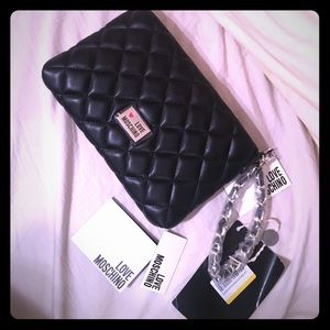 Love Moschino Handbags - Love Moschino wristlet with silver detail NWT