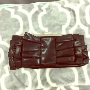 Black ruffled clutch purse with silver chain!