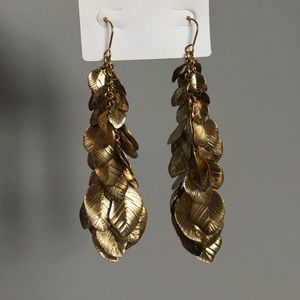 Gold colored leaf dangle earrings
