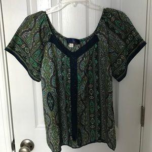 Francesca's patterned blouse