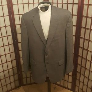 Men's medium grey plaid Jos A. Bank suit.