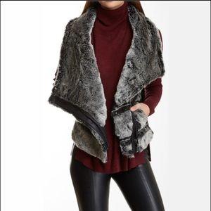 Vegan and faux fur vest.