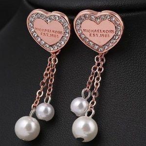 847b05c51a58b Michael Kors Jewelry - 💥Last Pair💥 Heart Rose Gold   Pearl MK earrings