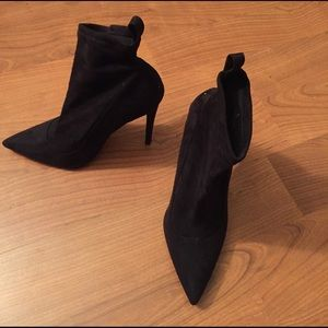 Stiletto suede like sock style ankle bootie.