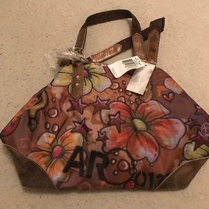 LeSportsac Handbags - NWT LeSportsac REMIX Bag Purse RARE