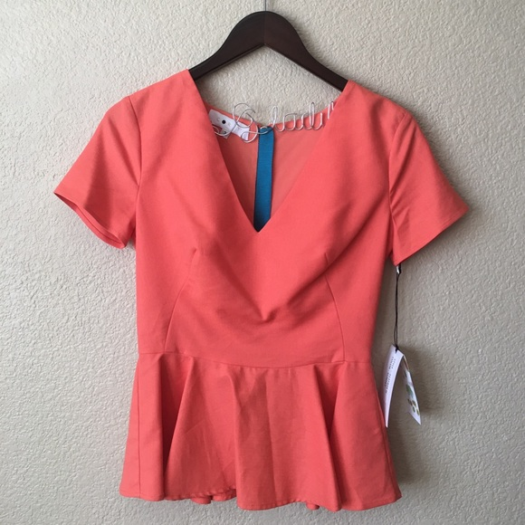Anthropologie Tops - Anthropologie Orange Linen Peplum Top