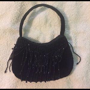 Little Black Bag with sparkle tassels