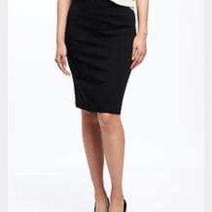 Knee length black skirt with slight white dots