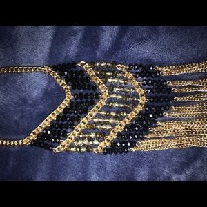 Gold necklace with black/copper/ blue beads