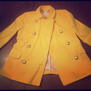 Bright yellow double breasted coat