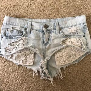 Carmar denim shorts with lace pockets
