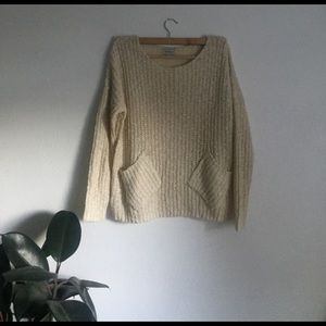 Slouchy knit sweater w/ front pockets.