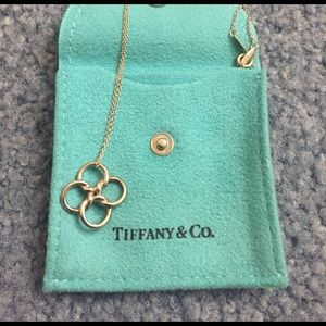 4 rings Tiffany necklaces