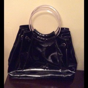Large Black Satchel with clear handles.