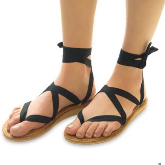 a0999c2413a9 Sseko Caramel Leather Stitch Ribbon Sandals. M 58c99751680278a5c8013c7e
