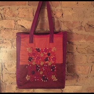 Cult of Individuality Handbags - Indian tribal design in fuchsia pink and purple.