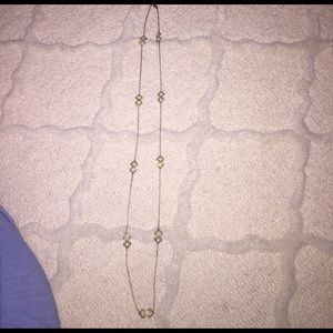 Jewelry - Long gold colored necklace.