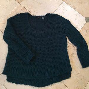 Deep blue-green sweater.