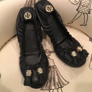 Tory Burch black flats with tassel.