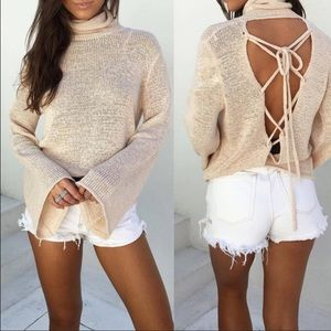 Beige open back light sweater