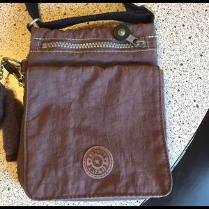 Kipling Handbags - Kipling cross body bag w/ lots of pockets & monkey