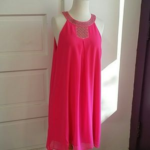 Pink beautiful dress with green details .