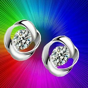 Jewelry - Swirl Stud Round Crystal Earrings in Silver Tone