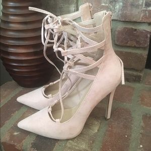 Blush lace up heels.