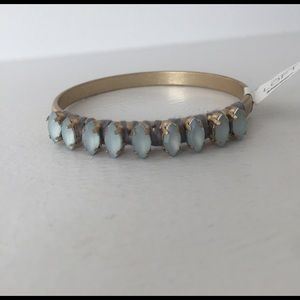 Antiqued gold bangle with light blue stones