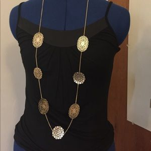 Long gold statement necklace