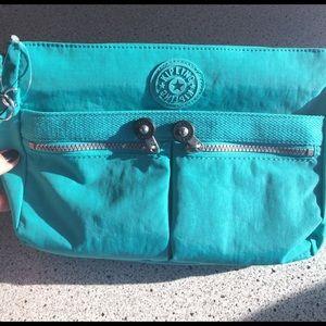 Kipling Handbags - NWT Kipling Angie cool turquoise bag w/ monkey