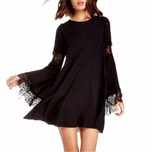 Dresses & Skirts - Dramatic lace mini dress