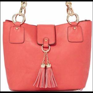 Coral and gold hardware handbag