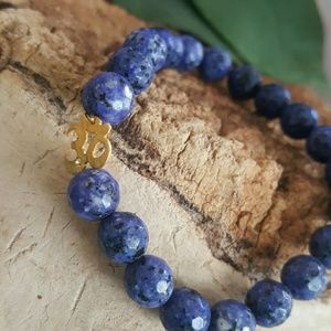 Jewelry - 18k gold om faceted  lapis lazuli strerch bracelet